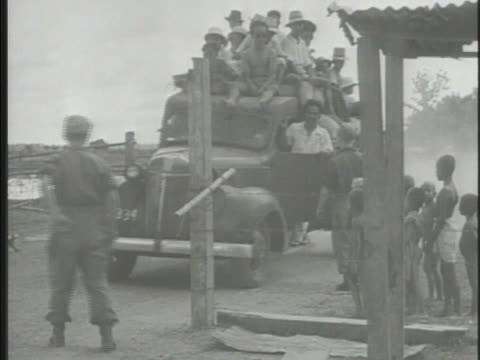truck full of indonesians at checkpoint dutch empire soldiers checking driver's papers dutch police patting down indonesians in line at gate... - indonesian ethnicity stock videos & royalty-free footage