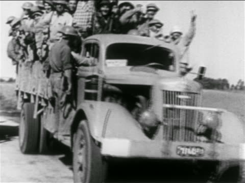 vidéos et rushes de b/w 1956 truck full of soldiers driving past camera / suez crisis / middle east / educational - 1956