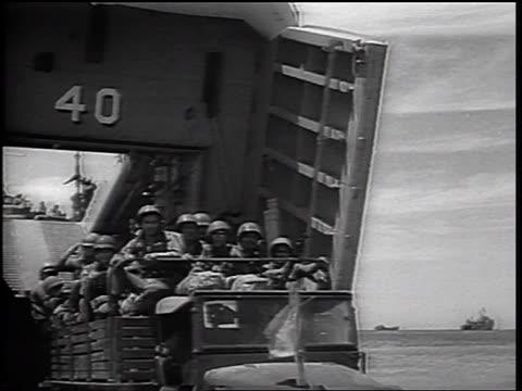 vídeos de stock, filmes e b-roll de b/w 1965 truck full of us marines driving from landing craft onto beach / vietnam war / newsreel - navio de desembarque de doca