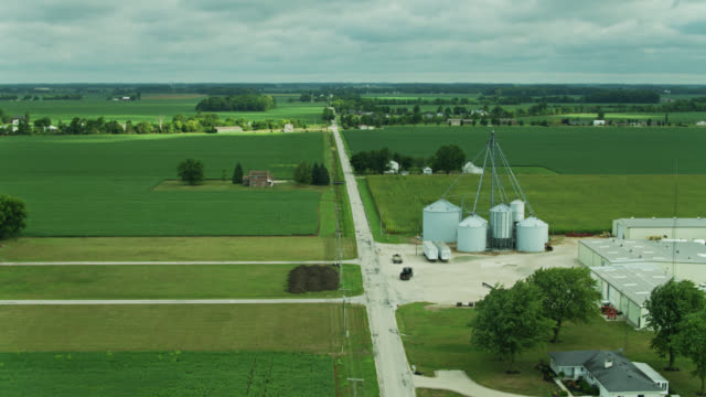 truck heading towards silo in rural ohio landscape - the way forward stock videos & royalty-free footage