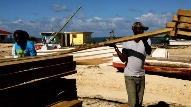 A truck is loaded with plywood on the nearly destroyed island of Barbuda on December 8 2017 in Cordington Barbuda Barbuda which covers only 62 square...