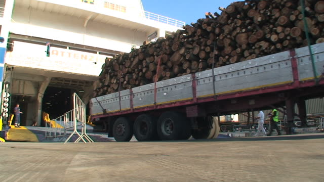 truck loaded with timber embarking on a ferry-boat - reversing stock videos & royalty-free footage