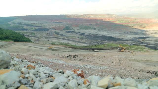 Truck loading coal mine to automatic conveyor