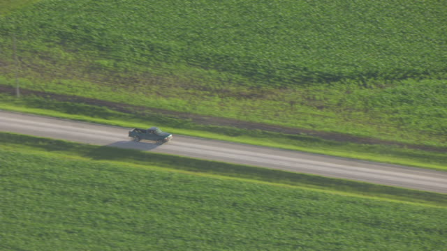 WS TS AERIAL POV Truck moving on road / Henry County, Iowa, United States