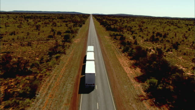WS TS AERIAL Truck on desert road, Alice Springs, Northern Territory, Australia