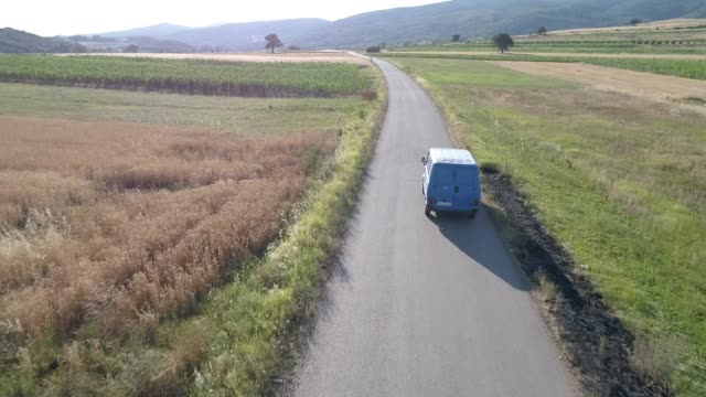 truck on the country road in the summer - van stock videos & royalty-free footage