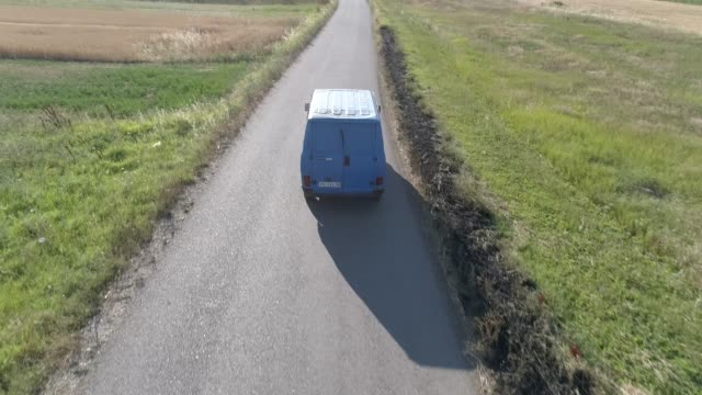 truck on the country road in the sunset - furgone video stock e b–roll