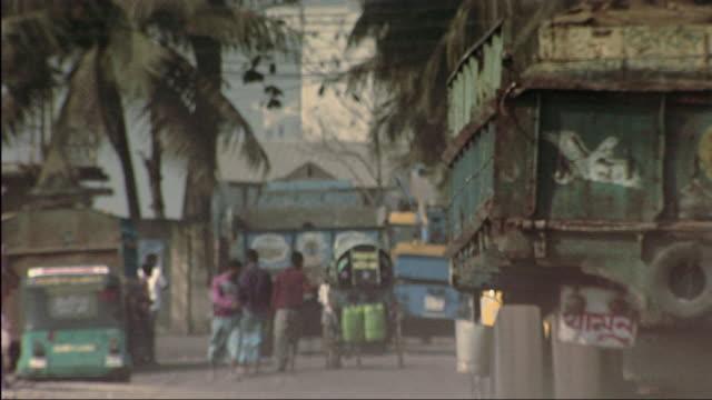 ws pan truck passing through ship yard / dhaka, bangladesh - bangladesh stock videos and b-roll footage