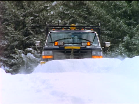 truck plowing snow towards camera - snowplough stock videos & royalty-free footage