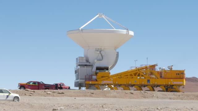 truck positioning a astronomical radio telescope antenna in the ground - atacama large millimeter array stock videos and b-roll footage