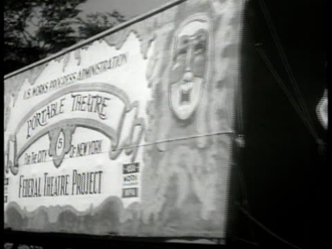 truck pulling portable theatre stage 'federal theatre project wpa' ws 'the minstrel' show performers on stage cu theatre posters ha ws scattered... - theatrical performance stock videos and b-roll footage