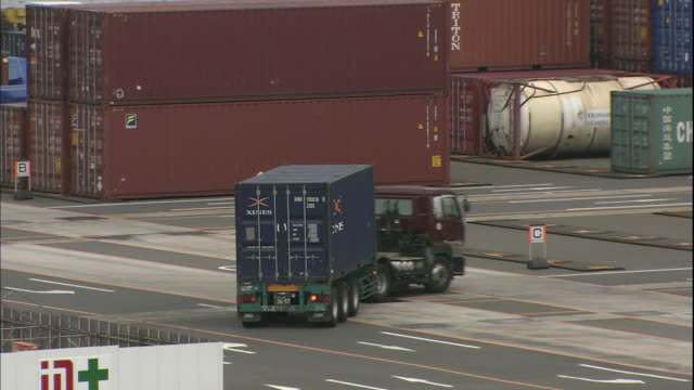 A truck pulls a container through a container yard in the Osaka South Port in Japan.