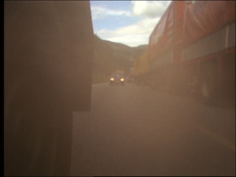 Truck rear point of view with exhaust of traffic on highway / Brenner Highway, Tyrol, Austria