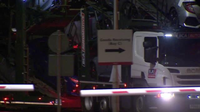 vídeos de stock, filmes e b-roll de truck removing honda vehicles after the company closed its factory in swindon - carregar