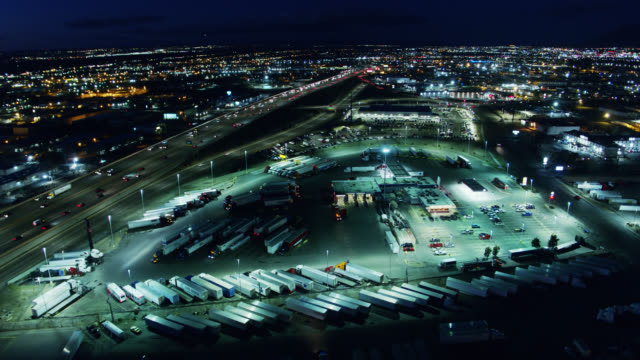 truck stop in albuquerque at night- drone shot - new mexico stock videos & royalty-free footage