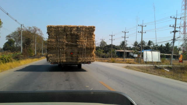 truck straw - hay bail stock videos & royalty-free footage