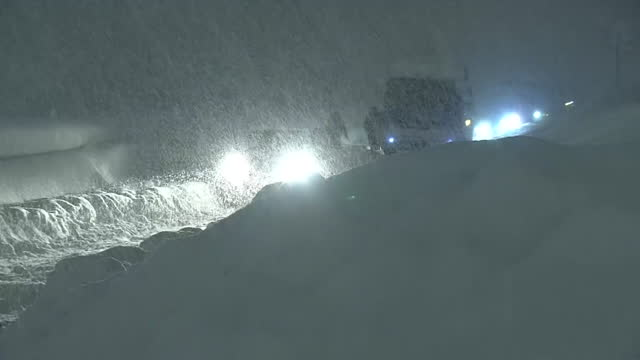 a truck stuck in blizzard, niigata, japan - extreme weather stock videos & royalty-free footage