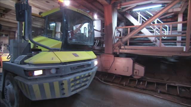 a truck tows a concrete mixer through a bore site. - cement mixer stock videos & royalty-free footage