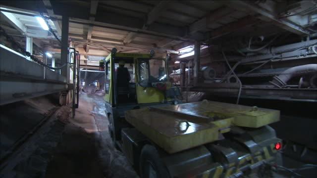 a truck tows a concrete mixer through a tunnel at a bore site. - cement mixer stock videos & royalty-free footage