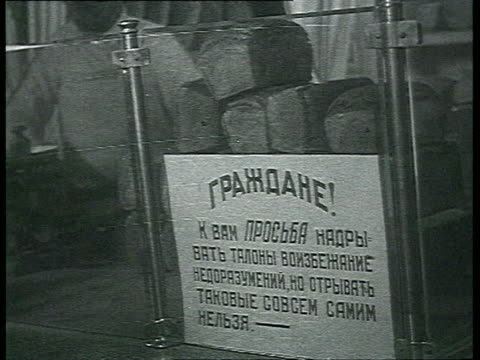 stockvideo's en b-roll-footage met truck transporting bread, bread stall with notice asking for ration coupon / moscow, russia - 1935