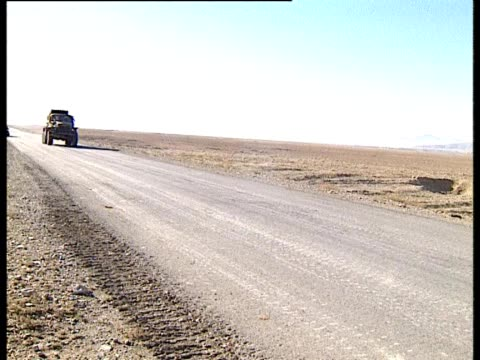 truck travelling along desert road - afghanistan stock videos & royalty-free footage