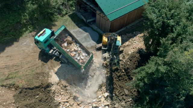 aerial truck unloading building debris - built structure stock videos & royalty-free footage