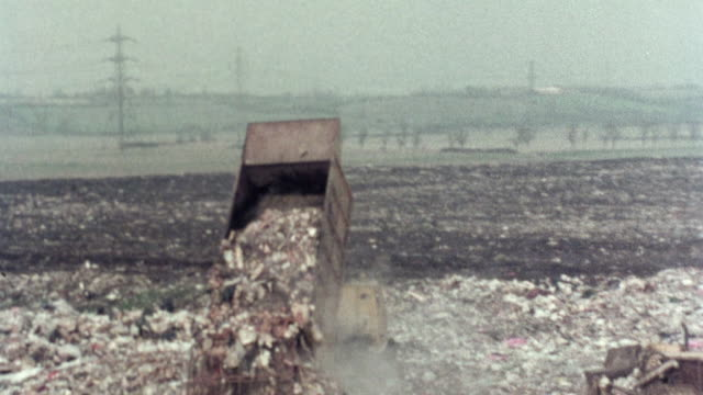1976 AERIAL A truck unloading garbage at a landfill / Stevenage, Hertfordshire, United Kingdom