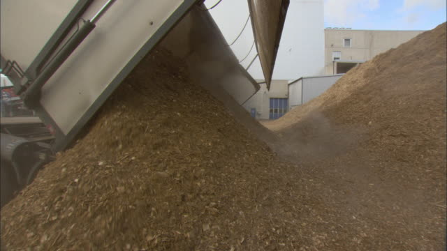 ms truck unloading pile of woodchips at biomass plant / vaxjo, sweden - vaxjo stock videos & royalty-free footage