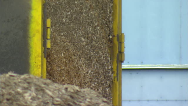 cu td tu truck unloading pile of woodchips at biomass plant / vaxjo, sweden - vaxjo stock videos & royalty-free footage