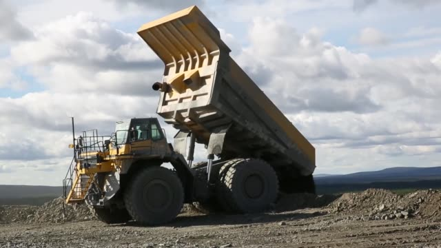 A truck unloads waste stone and iron ore from the open cast iron ore mine run by LKAB Sweden's stateowned mining company in Svappavaara near Kiruna...