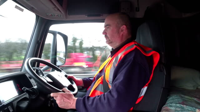 4K: Truck / Wagon driver in his cab driving