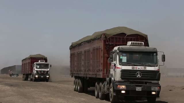 truck which is carrying coal to a reloading facility on the border with china, in south gobi, passes along road, a truck carrying coal at a reloading... - mongoliet bildbanksvideor och videomaterial från bakom kulisserna