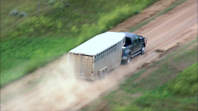 truck with horsebox - aerial view - south dakota,  perkins county,  united states - pick up truck stock videos and b-roll footage