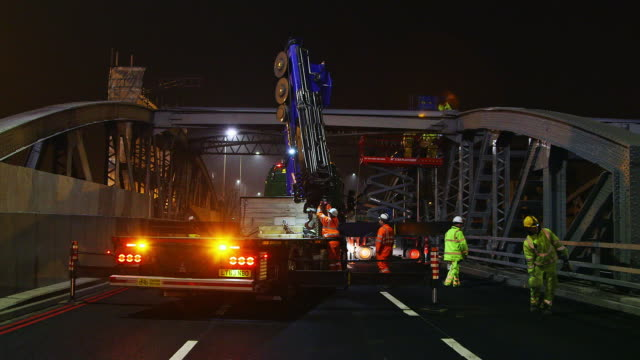 WS Truck with mobile crane parked on arch bridge / London, England, United Kingdom