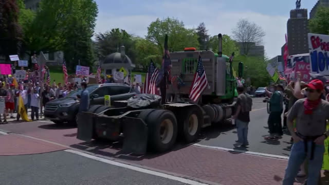 "truck with the words ""jesus is my vaccine"" drives past the capitol building in harrisburg, pennsylvania during a protest to support reopening amid... - human rights or social issues or immigration or employment and labor or protest or riot or lgbtqi rights or women's rights stock videos & royalty-free footage"
