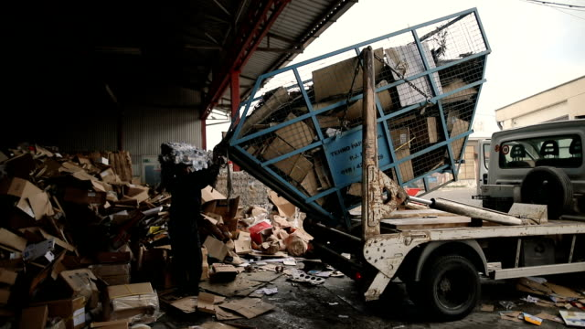 Truck with waste paper brought the carton in a recycling center