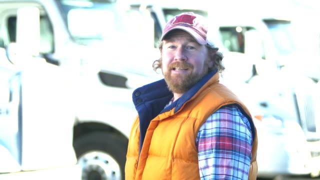 trucker standing in front of semi-trucks, talking - trucks in a row stock videos & royalty-free footage