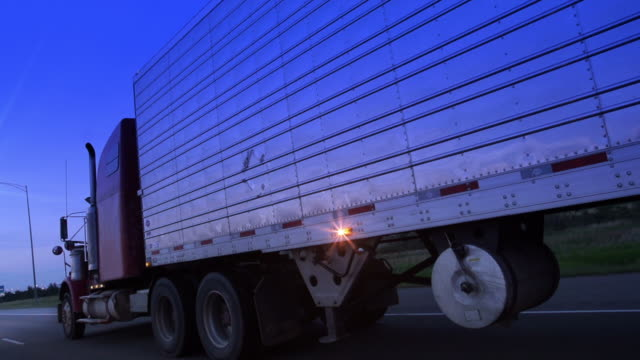 trucking down the highway - articulated lorry stock videos & royalty-free footage