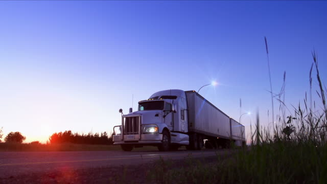 trucking industry - articulated lorry stock videos & royalty-free footage