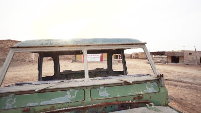 Trucking shot, abandoned vehicle in Ras al-Khaimah