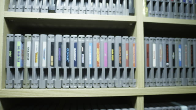 trucking shot, enormous video game collection - cartridge stock videos & royalty-free footage