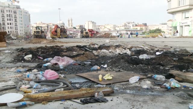 trucks and bulldozers clean taksim square and gezi park after turkish police forced protesters to leave the place using tear gas and water cannon... - baufahrzeug stock-videos und b-roll-filmmaterial