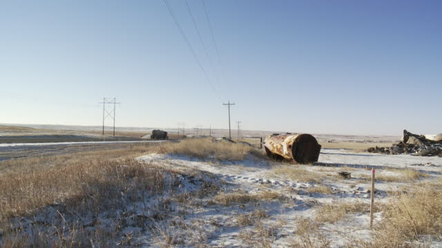Trucks and cars in winter on road outside of Williston, North Dakota, USA.