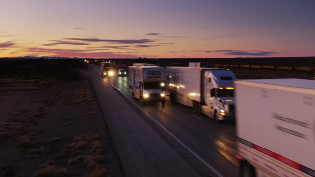 trucks and cars on interstate in new mexico at sunset - interstate 10 stock videos & royalty-free footage