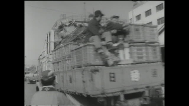trucks and carts transport cargo past commercial buildings near the akihabara railway station. - akihabara station stock videos and b-roll footage