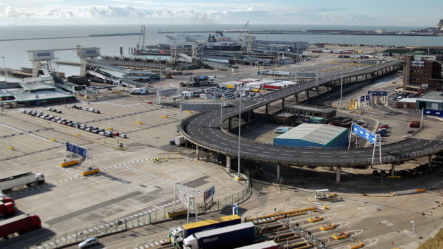 t/l trucks and ferries arriving and departing at sea port / dover, england, united kingdom - dover england stock videos and b-roll footage