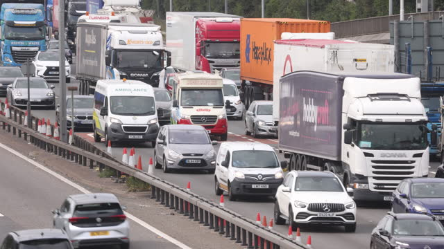 trucks and hgv's around m25 motorway in dartford, kent, u.k., on friday, september 3, 2021. - on the move stock videos & royalty-free footage