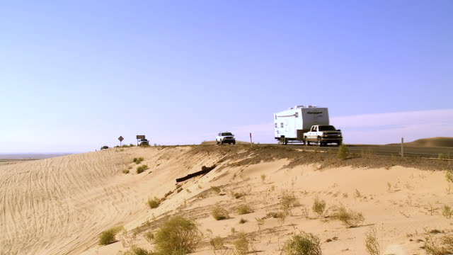 ws trucks and trailers on highway 78 through sand dunes / glamis, california, usa - trailer stock videos & royalty-free footage