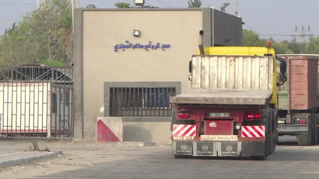 trucks are seen at the gate of the partially closed kerem shalom crossing the main passage point for goods entering gaza in the southern gaza strip... - exclusion stock videos & royalty-free footage