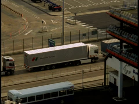 stockvideo's en b-roll-footage met t/l trucks at dover docks - high angle view, trucks queue and pass through customs - veerboothaven